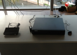 (From left to right) Mobile display, 5.8GHz transmitter, DVR and a mouse