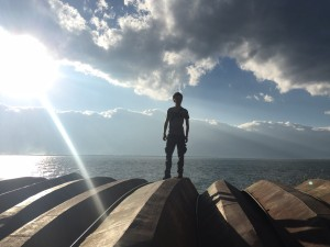 Me posing on top of boats beside Erhai lake in Dali. Photo by Katherine Sng