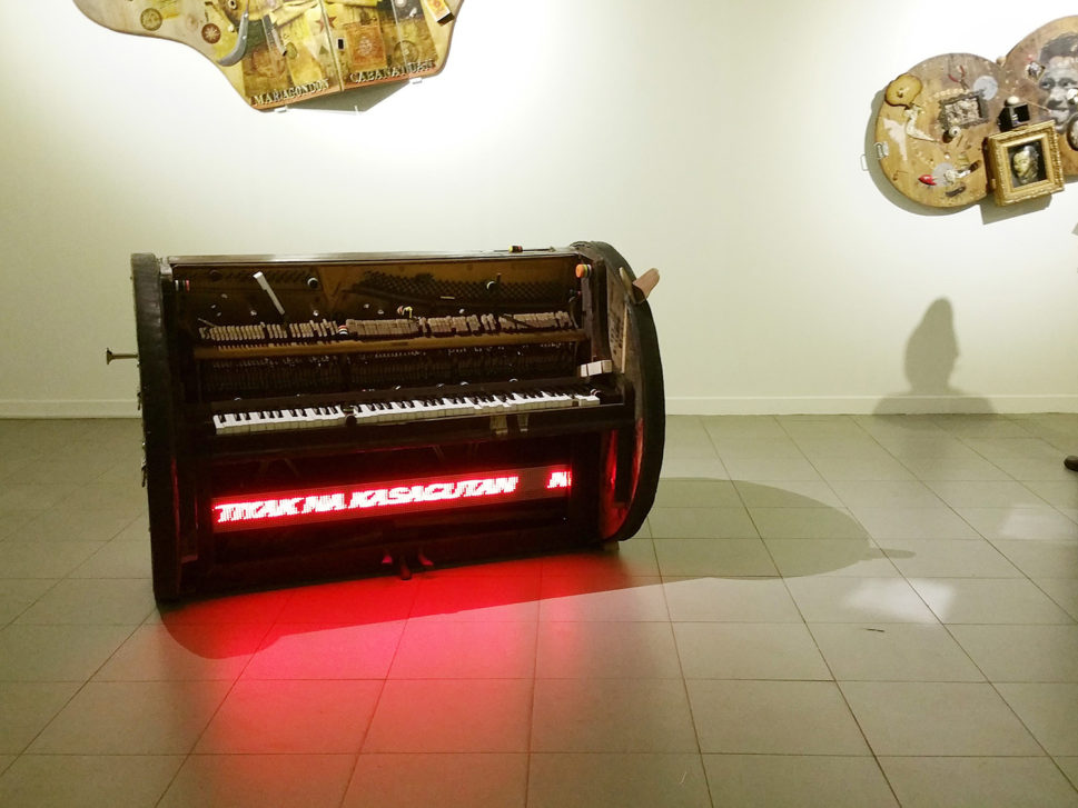 Akwin Reamillo's Piano with changing colors LED panel marquee text