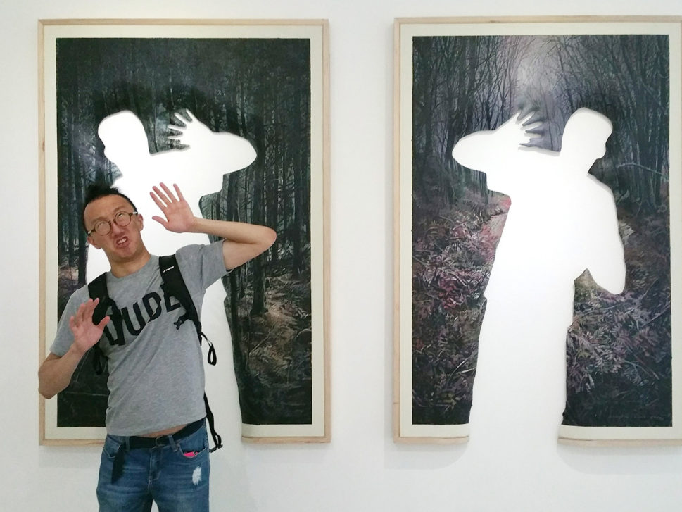 Taufik Ermas cut out the silhouette of a frightened person in the woods out of his painting. cool